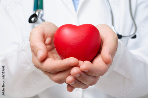 Doctor protecting a heart Poster