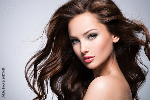 Beautiful woman with long curly hair Poster