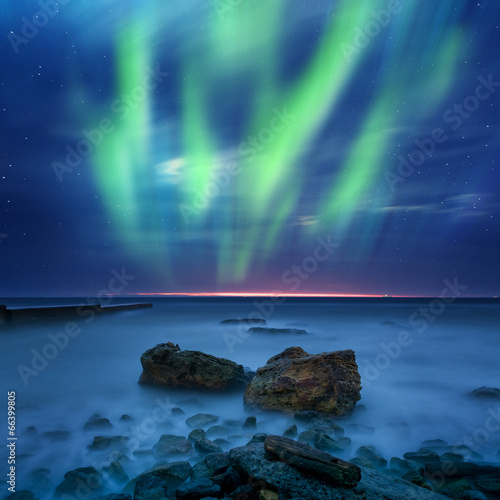 aurora borealis over the sea Poster