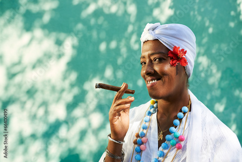 Portrait of cuban black woman smoking cigar