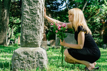 Woman Grieving At Grave
