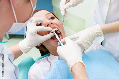 Female patient in dentist office getting tooth  procedure Fototapet