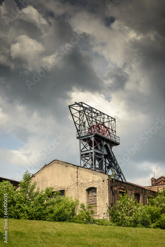 Old building,shaft coal mine and dramatic sky.