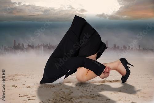 Obraz na płótnie Composite image of businesswoman burying her head