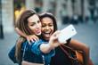 canvas print picture - Multi ethnic Friends having fun in city taking selfie