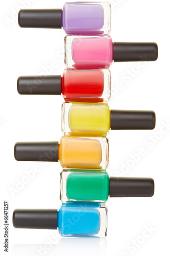 Photographie  Nail polish bottles colorful stack on white, clipping path