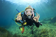 Young Woman Scuba Diving Signa...