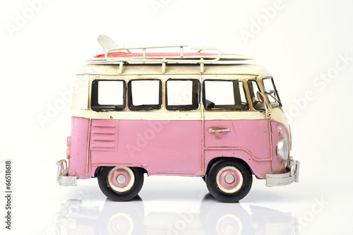 Pink old toy car with surfboard.