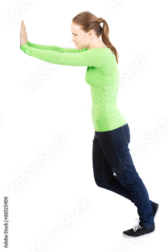 Fotografía  Woman pushing something imaginary