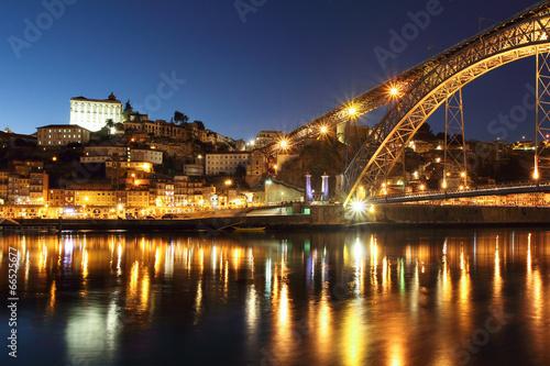Dom Luis bridge and Porto at dusk