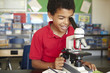 canvas print picture - Boy in science class with microscope