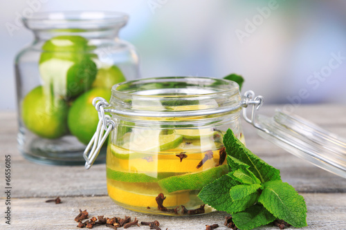Canvas Prints Tea Pickled limes and cloves in glass jar,