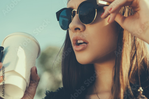 Beautiful hipster woman with cup of coffee Fototapet