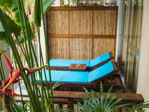 Fototapeta Beach chairs in tropical resort obraz na płótnie