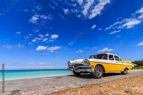 Poster de jardin Havana Classic taxi parked near the beach in Vinales, Cuba