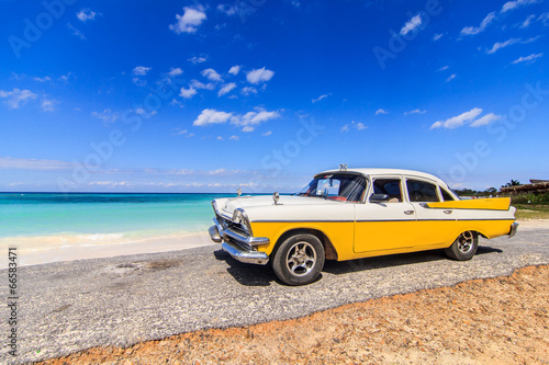 Classic taxi parked near the beach in Vinales, Cuba Poster