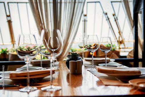 Fotobehang Restaurant Served table with glasses