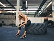 Female athlete taking rest after tough crossfit workout