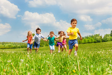Running Kids In Green Field Du...