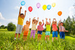 canvas print picture Happy kids with balloons and arms up in the sky