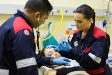 Paramedics Examining Patient
