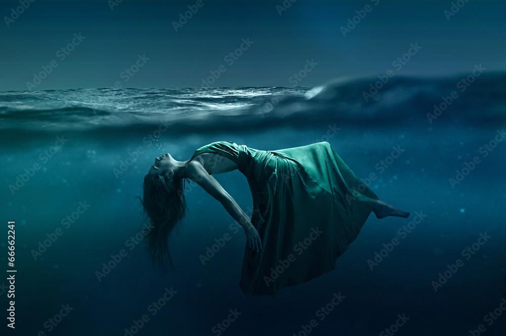 Fototapety, obrazy: Woman floating underwater