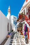 Fototapeta Uliczki - Small white chapel in an alley of Chora in Mykonos