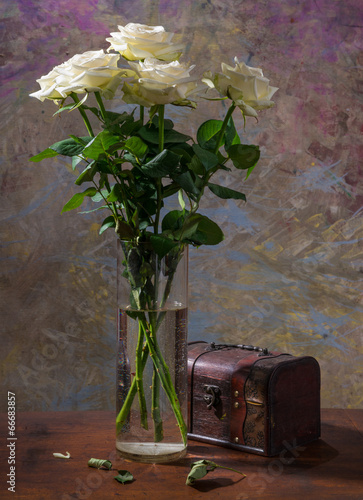 White roses in  vase and box
