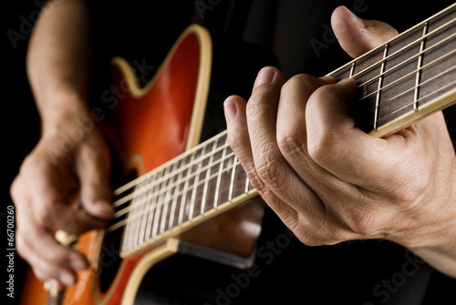 Photo  playing country guitar
