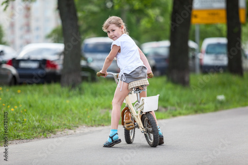 Recess Fitting Cycling Happy girl riding a bicycle