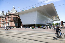 AMSTERDAM, NETHERLANDS, JUNE 8 2014: People Walking Or Cycling A
