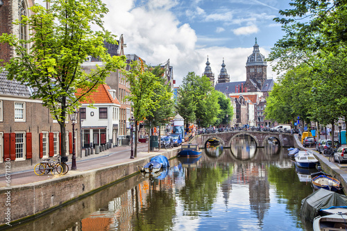 Canal and St. Nicolas Church in Amsterdam Wallpaper Mural