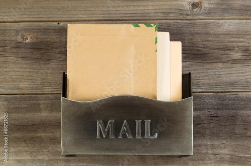 Fotografie, Obraz  Old Metal Mailbox on Weathered Wood