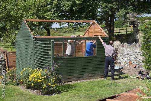 Fotografía Demolishing a garden shed