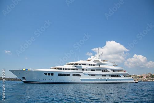Fotografia  Luxury large super or mega motor yacht in the blue sea.