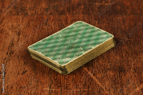 Photo  deck of old cards on wooden table