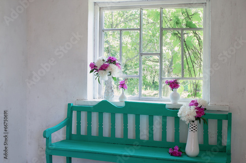 Fotografie, Obraz  green bench at window and flowers in vases