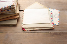 Stack Of Vintage Letters On Wooden Table