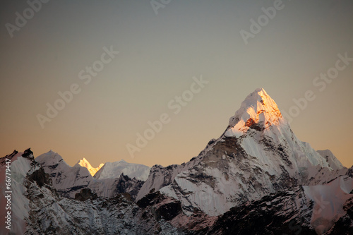 Ama Dablam peak at sunset. Poster