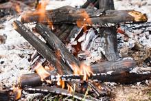 Smoldering Broken Bonfire With...