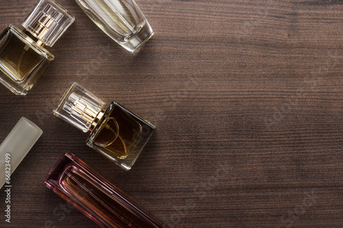 Fototapeta different perfume bottles on the table obraz