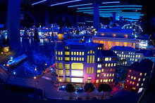 Miniature Model Of The City At Night With River And Buildings