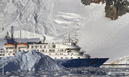 Recess Fitting Antarctic tourist ship on the background of mountains and glaciers of the