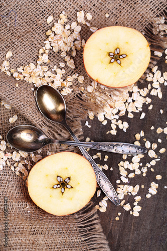 Apple with oatmeal and vintage spoons © Africa Studio