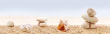 Panorama Of Zen Stones On A Sandy Beach.