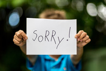 Boy With Sorry Sign