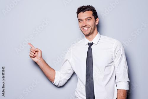 Valokuva  Businessman pointing copy space.