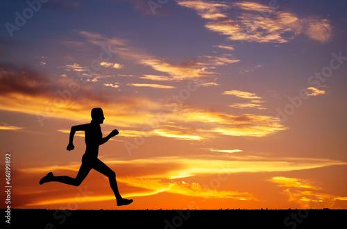 Deurstickers Vechtsport Silhouette of running man on sunset fiery background