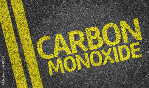Vászonkép Carbon Monoxide written on the road