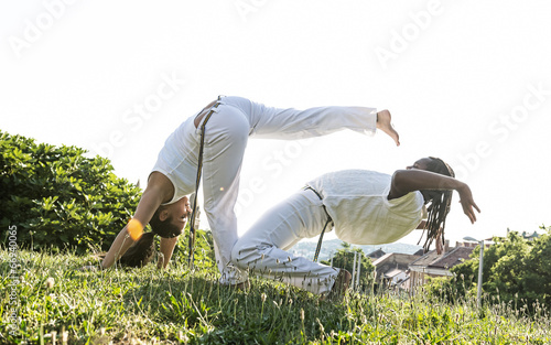 Garden Poster Martial arts Capoeira woman, awesome stunts in the outdoors